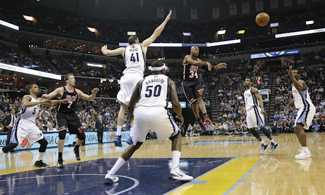 Miami Heat guard Ray Allen (34) passes away from Memphis Grizzlies defenders Kosta Koufos (41) and Zach Randolph (50) in the first half of an NBA basketball game Wednesday, April 9, 2014, in Memphis, Tenn. (AP Photo/Mark Humphrey)