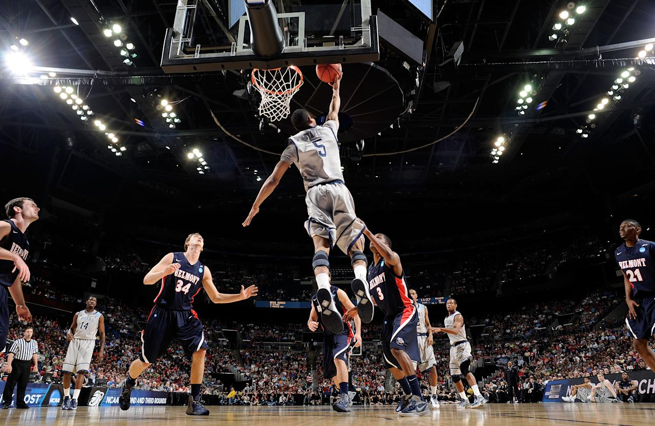 COLUMBUS, OH - MARCH 16: Markel Starks #5 of the Georgetown Hoyas goes up for a reverse layup against Kerron Johnson #3 and Mick Hedgepeth #34 of the Belmont Bruins in the first half during the second round of the 2012 NCAA Men's Basketball Tournament at Nationwide Arena on March 16, 2012 in Columbus, Ohio.  (Photo by Jamie Sabau/Getty Images)