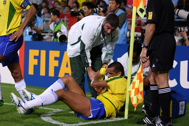 Rivaldo reacts after being hit in the 'face' by the ball
