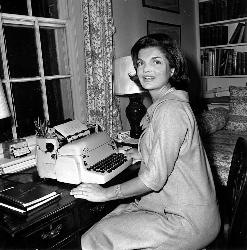 """FILE - In this Oct. 5, 1960 file photo, Jacqueline Kennedy poses at her typewriter where she writes her weekly """"Candidate's Wife"""" column in her Georgetown home in Washington.  President John F. Kennedy openly scorned the notion of Vice President Lyndon Baines Johnson succeeding him in office, according to a book of newly released interviews with his widow, former first lady Jacqueline Kennedy.  (AP Photo/File)"""