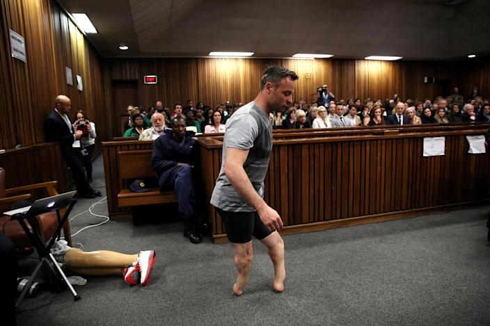 <p>JUN. 15, 2016 — Paralympic gold medalist Oscar Pistorius walks across the courtroom without his prosthetic legs during the third day of the resentencing hearing for the 2013 murder of his girlfriend Reeva Steenkamp, at Pretoria High Court, South Africa. (Siphiwe Sibeko/Reuters) </p>
