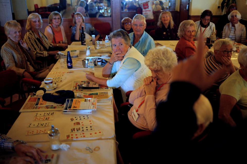 British retirees living in Spain play bingo as they gather for a coffee morning organised by a charity at a bar in Fuengirola, near Malaga, southern Spain, November 17, 2016. While some retirees still prefer more typical post-work activities, others are pursuing passion projects when they leave their careers. (REUTERS/Jon Nazca)