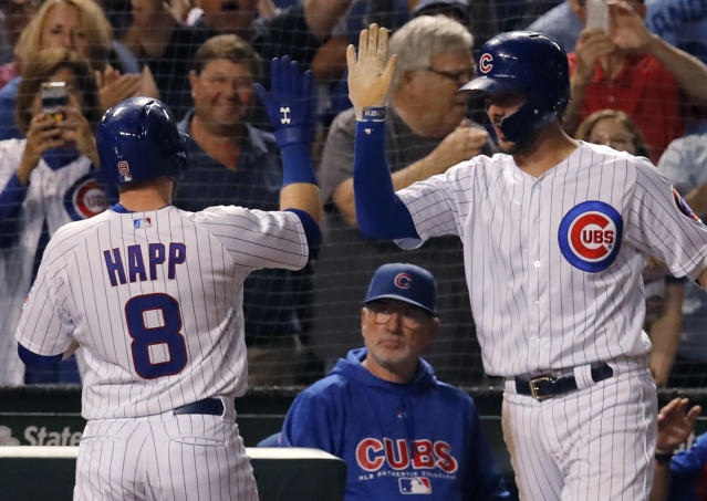 Chicago Cubs' Ian Happ, left, celebrates his three-run home run against the Cincinnati Reds with teammate Kris Bryant, right, as manager Joe Maddon looks on during the seventh inning of a baseball game Friday, Sept. 14, 2018, in Chicago. (AP Photo/Jim Young)
