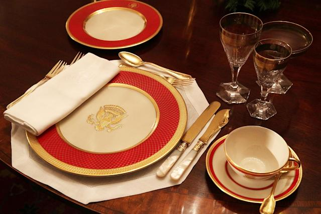 "<p>Place setting is seen on a dining table in the China Room at the White House during a press preview of the 2017 holiday decorations Nov. 27, 2017 in Washington, D.C. The theme of the White House holiday decorations this year is ""Time-Honored Traditions."" (Photo: Alex Wong/Getty Images) </p>"