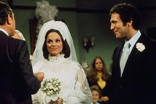 Rhoda and Joe (Rhoda):  Following a relatively whirlwind relationship, Joe and Rhoda decide to take the plunge, inviting friends, family, and the Mary Tyler Moore cast to celebrate. But as luck would have it, Rhoda runs late, and in one of the most memorable TV scenes in sitcom history, she makes her way through Queens in a wedding dress and a cardigan, barely making the ceremony on time.