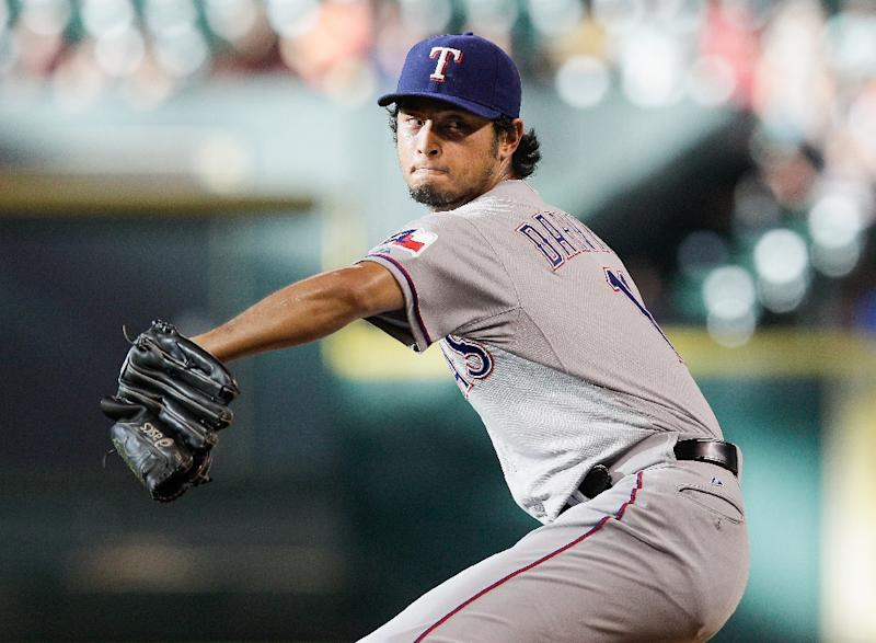 Yu Darvish #11 of the Texas Rangers throws a pitch against the Houston Astros on August 9, 2014 in Houston, Texas