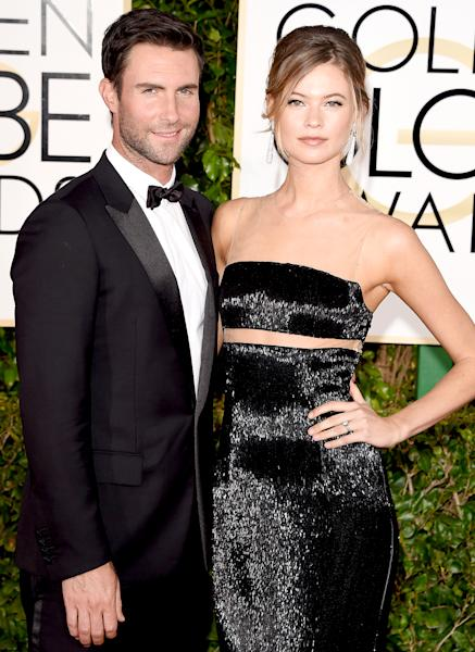 Behati Prinsloo gave birth to a baby girl, her first child with husband Adam Levine — read more