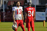 Tampa Bay Buccaneers wide receiver Mike Evans (13) talks to cornerback Carlton Davis III (24) during an NFL football training camp practice Wednesday, Aug. 11, 2021, in Tampa, Fla. (AP Photo/Chris O'Meara)