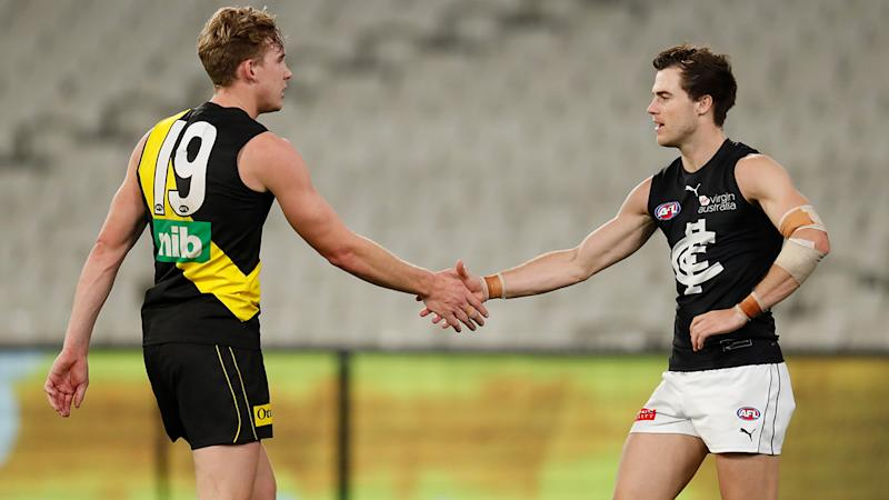 Tom Lynch and Lachie Plowman, pictured here shaking hands after the match.