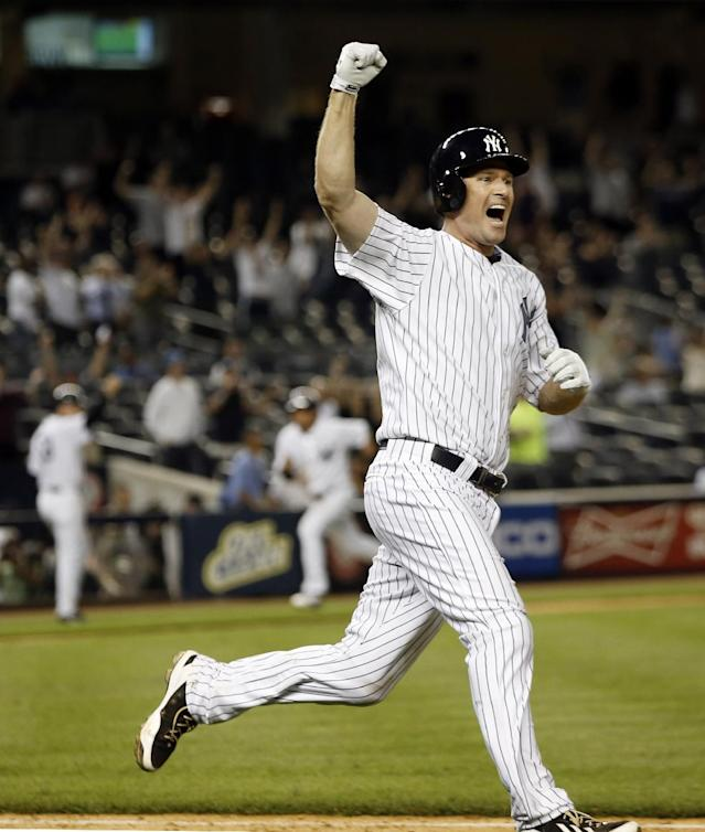 New York Yankees Chase Headley, acquired Tuesday in a trade with the San Diego Pardres, celebrates as he runs to first base after hitting a game-winning, walk-off RBI single to lift the Yankees to a 14th inning, 2-1 victory over the Texas Rangers in a baseball game at Yankee Stadium in New York, Wednesday, July 23, 2014. (AP Photo)
