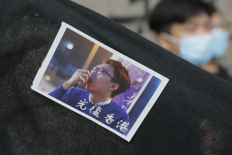 "A sticker featuring a picture of Hong Kong activist Edward Leung with Chinese words which read ""Liberate Hong Kong,"" is displayed outside the High Court in Hong Kong, Wednesday, Oct. 9, 2019. Last year, Leung was sentenced to six years in prison for his part in a violent nightlong clash with police over illegal street food hawkers two years ago. (AP Photo/Kin Cheung)"