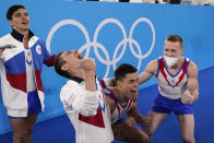 Russian Olympic Committee's artistic gymnastics men's team, from right, Denis Abliazin, right, Nikita Nagornyy, David Belyavskiy and Artur Dalaloyan celebrate after winning the gold medal at the 2020 Summer Olympics, Monday, July 26, 2021, in Tokyo. (AP Photo/Gregory Bull)