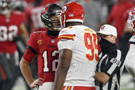 Tampa Bay Buccaneers quarterback Tom Brady (12) exchanges words with Kansas City Chiefs defensive tackle Chris Jones (95) as referee Shawn Hochuli (83) tries to separate the two during the second half of an NFL football game Sunday, Nov. 29, 2020, in Tampa, Fla. (AP Photo/Jason Behnken)