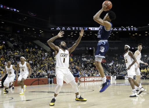 Rhode Island's Jeff Dowtin (11) shoots over VCU's Mike'L Simms (1) during the second half of an NCAA college basketball game in the Atlantic 10 men's tournament Friday, March 15, 2019, in New York. Rhode Island won 75-70. (AP Photo/Frank Franklin II)