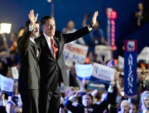 Paul Ryan, left, joins Mitt Romney after the Republican presidential nominee's acceptance speech in Tampa, Fla.