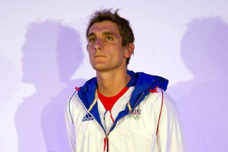 File photo of France's triathlon competitor Laurent Vidal attending a ceremony to mark the 100 day point before the opening ceremony for the London 2012 Olympic Games, in Paris April 18, 2012. REUTERS/Charles Platiau