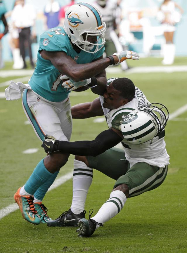 <p>Miami Dolphins wide receiver Jarvis Landry (14) runs the ball as New York Jets free safety Marcus Gilchrist (21), attempts to make the tackle, during the first half of an NFL football game, Sunday, Nov. 6, 2016, in Miami Gardens, Fla. (AP Photo/Wilfredo Lee) </p>