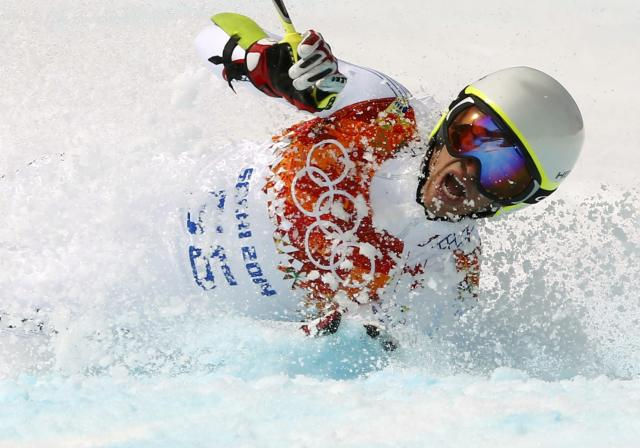 Andorra's Joan Verdu Sanchez crashes during the first run of the men's alpine skiing giant slalom event at the 2014 Sochi Winter Olympics at the Rosa Khutor Alpine Center February 19, 2014. REUTERS/Ruben Sprich (RUSSIA - Tags: SPORT SKIING OLYMPICS)