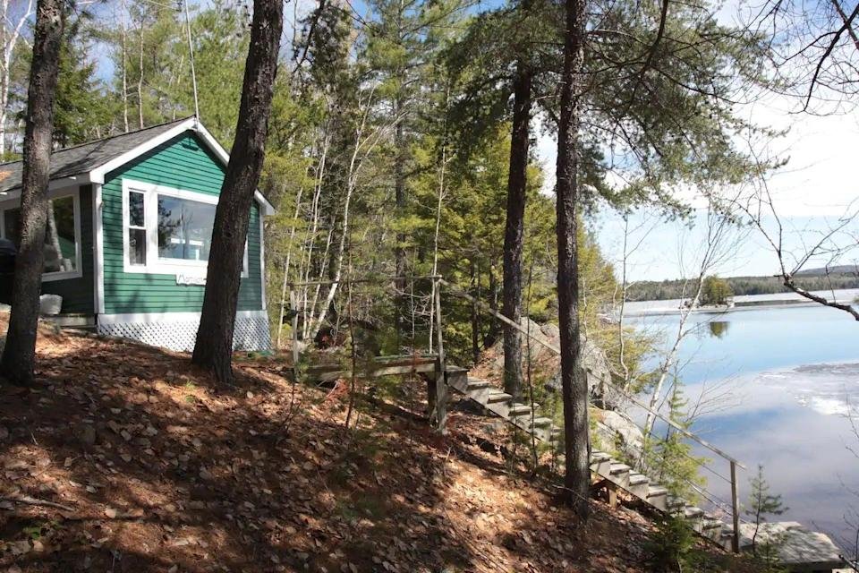 """<h2>Baxter State Park, Maine</h2><br><strong>Location: </strong>Millinocket, Maine<br><strong>Sleeps: </strong>4<br><strong>Price Per Night: </strong><a href=""""https://airbnb.pvxt.net/zaNgMW"""" rel=""""nofollow noopener"""" target=""""_blank"""" data-ylk=""""slk:$175"""" class=""""link rapid-noclick-resp"""">$175</a><br><br>""""Kiss all your cares goodbye, rest and relax, or seek out the many adventures here in the great north woods. Even during this crisis, I invite you to come to Bear's Den where I am doing everything in my power to clean and disinfect my camp thoroughly between each guest. We are on a peninsula overlooking Deep Cove and Ambajejus Lake. Just 11 miles from Baxter State Park, 40 min to Katahdin woods and waters. Bears Den is a cozy cabin nestled in the woods on 1.5 acres. It can sleep two or three adults, or two adults and two children. The camp is situated on a peninsula overlooking Deep Cove, and you have a beach on the other side of the road on Ambajejus Lake with a view of Mt. Katahdin. Sunrise on the cove side, and sunset on the beach side!! The views from the picture windows are stunning.""""<br><br><h3>Book <a href=""""https://airbnb.pvxt.net/zaNgMW"""" rel=""""nofollow noopener"""" target=""""_blank"""" data-ylk=""""slk:Bear's Den Lake House"""" class=""""link rapid-noclick-resp"""">Bear's Den Lake House</a></h3>"""