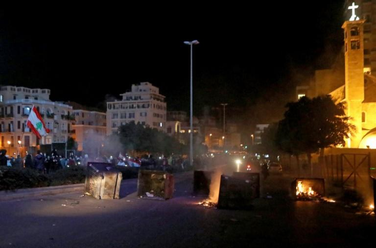 Lebanese protesters burn dumpsters as they block a road during an anti-government demonstration in Beirut (AFP Photo/PATRICK BAZ)