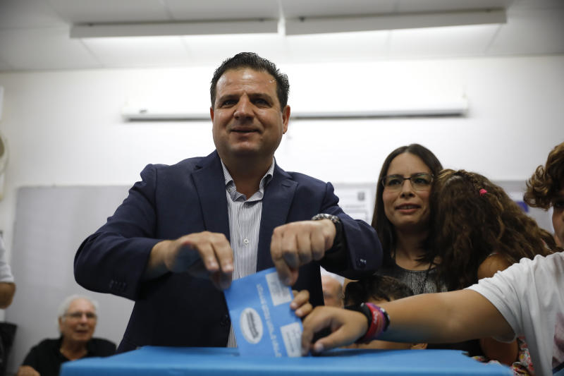 FILE - In this Tuesday, Sept. 17, 2019. file photo, Israeli Arab politician Ayman Odeh casts his vote in Haifa, Israel. Israel's Arab coalition appears poised to emerge as the main opposition bloc following Tuesday's vote. The historic first would grant a new platform to a long-marginalized minority and the only major political movement still pushing for peace with the Palestinians. (AP Photo/Ariel Schalit, File)