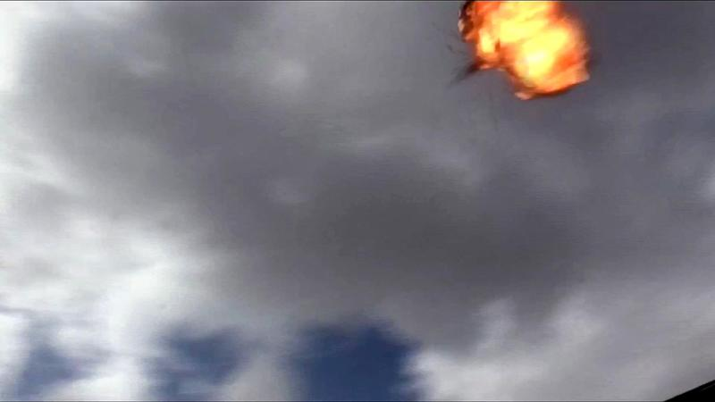 An image grab taken from a video obtained by AFPTV shows the moment a drone exploded above Yemen's Al-Anad airbase in the government-held southern province of Lahj on January 10, 2019