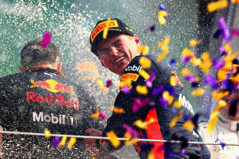 Race winner Max Verstappen of Netherlands and Red Bull Racing celebrate on the podium during the Formula One Grand Prix of Mexico, at Autodromo Hermanos Rodriguez in Mexico City, on October 29, 2017