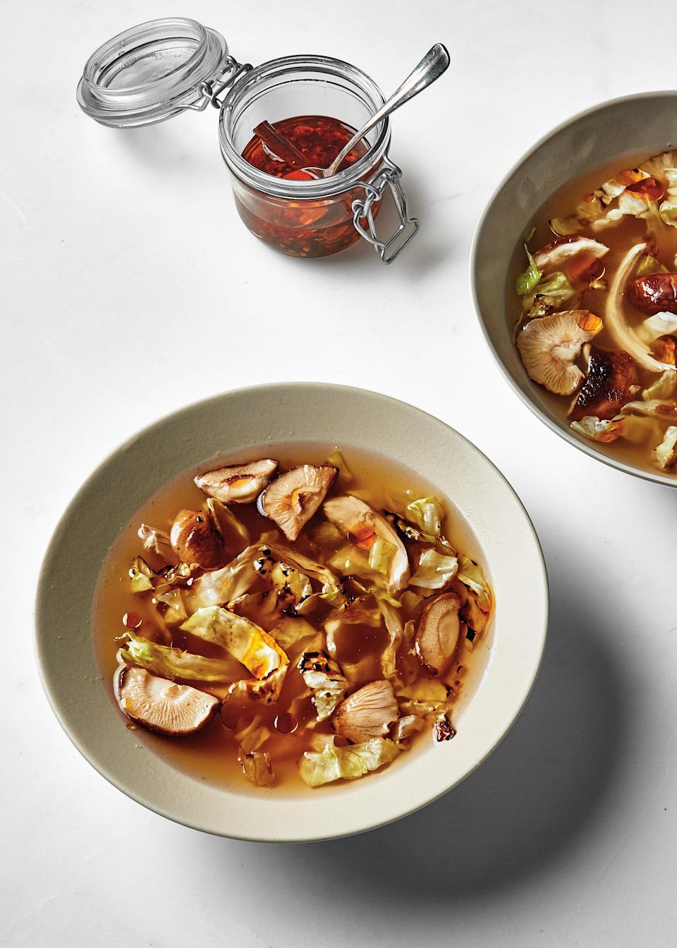 "Simmering a rotisserie bird in water with a handful of aromatics beats boxed chicken stock any day. Plus, the mushroom stems are basically free flavor; add a handful to any pot of simmering stock for an umami boost. <a href=""https://www.bonappetit.com/recipe/chicken-soup-with-charred-cabbage?mbid=synd_yahoo_rss"" rel=""nofollow noopener"" target=""_blank"" data-ylk=""slk:See recipe."" class=""link rapid-noclick-resp"">See recipe.</a>"
