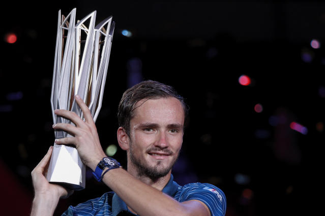 Daniil Medvedev of Russia poses with his winner's trophy after defeating Alexander Zverev of Germany in the men's final at the Shanghai Masters tennis tournament at Qizhong Forest Sports City Tennis Center in Shanghai, China, Sunday, Oct. 13, 2019. (AP Photo/Andy Wong)