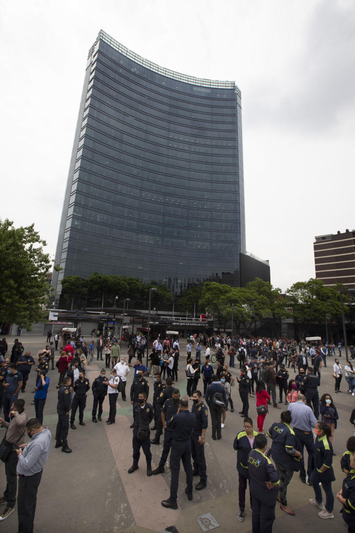 Residents stand in the pedestrian walkway of the Insurgentes roundabout after an earthquake in Mexico City on Tuesday, June 23, 2020. The earthquake struck near the Huatulco resort in southern Mexico on Tuesday morning, swayed buildings in Mexico City and sent thousands fleeing into the streets. (AP Photo/Marco Ugarte)