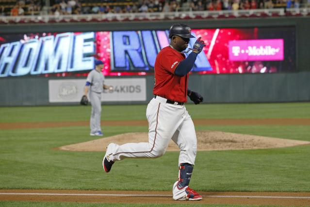 Minnesota Twins' Miguel Sano jogs home on a solo home run off Kansas City Royals pitcher Mike Montgomery, background, during the third inning of a baseball game Thursday, Sept. 19, 2019, in Minneapolis. (AP Photo/Jim Mone)