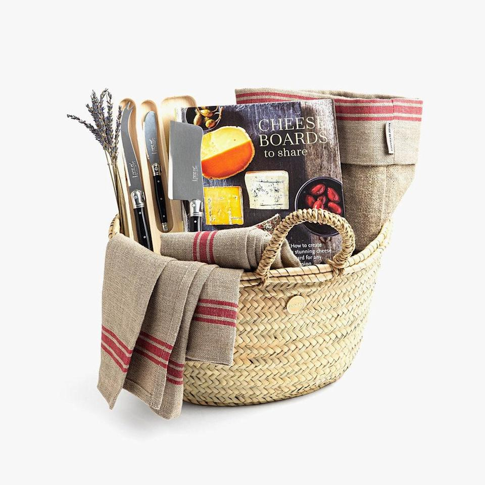 """Annie Clo makes gift giving easy with their pre-assembled gift basket—this one for the cheese lover. To give their baskets is to give the impression you have much more time on your hands than you actually might. $190, Annie Clo. <a href=""""https://annieclo.com/collections/shop-all-gifts/products/cheese-lover"""" rel=""""nofollow noopener"""" target=""""_blank"""" data-ylk=""""slk:Get it now!"""" class=""""link rapid-noclick-resp"""">Get it now!</a>"""