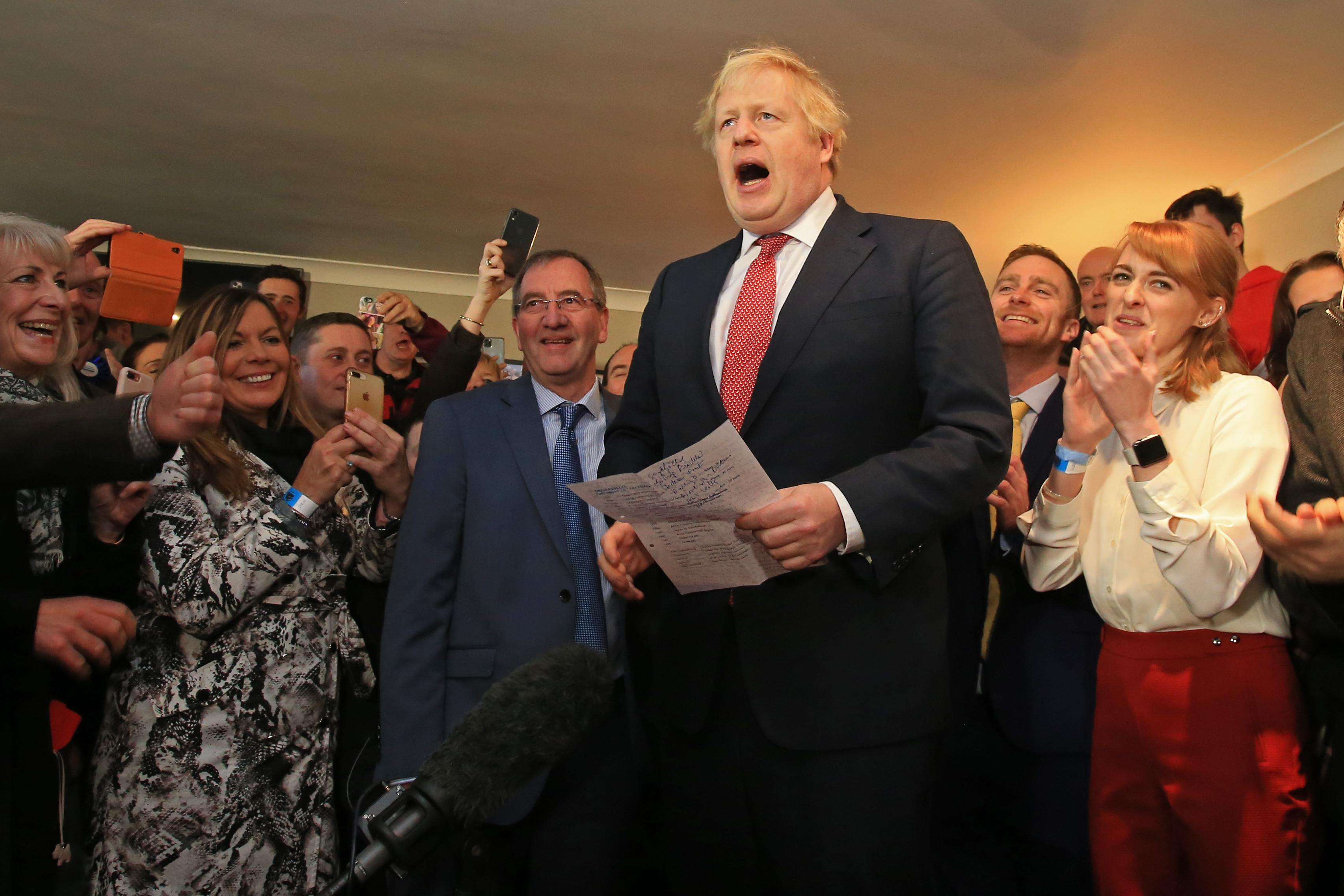 Prime Minister Boris Johnson speaks to supporters during a visit to see newly elected Conservative party MP for Sedgefield, Paul Howell during a visit to Sedgefield Cricket Club in County Durham.