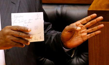 President of South Africa Cyril Ramaphosa holds his speech notes as he addresses MPs after being elected president in parliament in Cape Town, South Africa, February 15, 2018.   REUTERS/Mike Hutchings