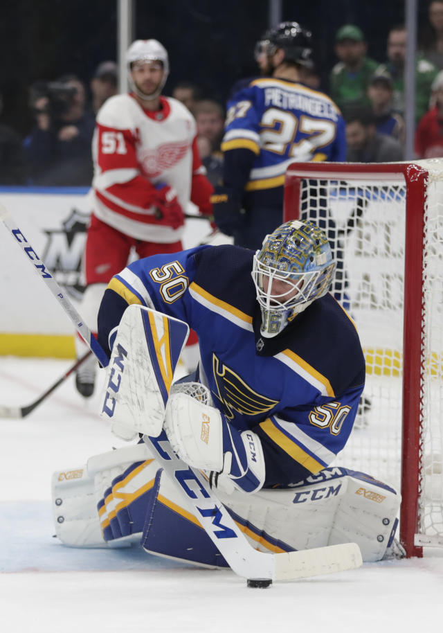 St. Louis Blues goaltender Jordan Binnington (50) makes a stick-save in the first period of an NHL hockey game against the Detroit Red Wings, Thursday, March 21, 2019, in St. Louis. (AP Photo/Tom Gannam)