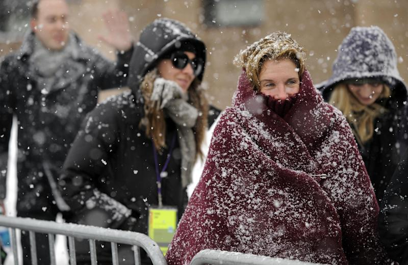 """FILE - This Jan. 22, 2010, file photo, Sundance Film Festival audience members wait in line in the snow for the premiere of the film """"Hesher"""" during the Sundance Film Festival in Park City, Utah, Friday, Jan. 22, 2010. A conservative Utah group believes the Sundance Film Festival's lineup featuring 'obscene' movies is at odds with Utah's culture of family values, and wants the state to pull its financial backing.(AP Photo/Chris Pizzello, File)"""