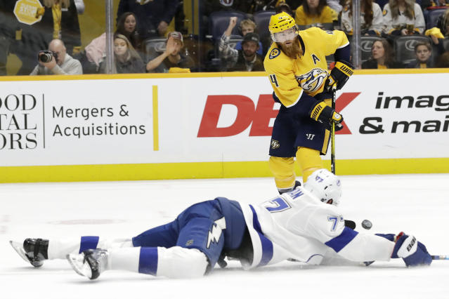 Tampa Bay Lightning defenseman Victor Hedman (77), of Sweden, tries to block a pass by Nashville Predators defenseman Ryan Ellis (4) in the second period of an NHL hockey game Tuesday, Dec. 3, 2019, in Nashville, Tenn. (AP Photo/Mark Humphrey)