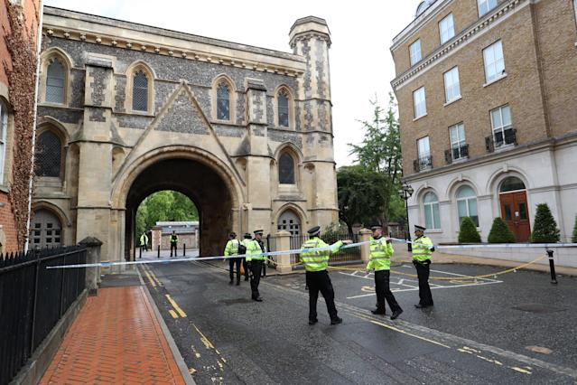 Police at the Abbey gateway of Forbury Gardens in Reading town centre following a terror attack on Saturday (PA)