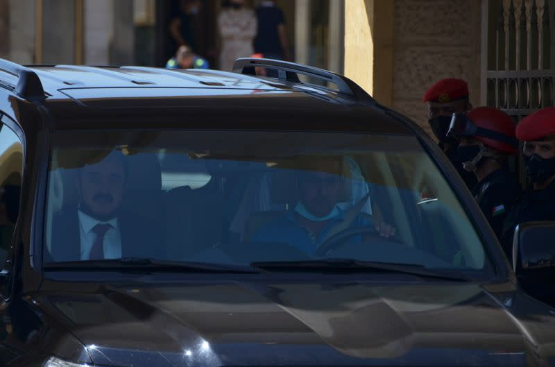 Mohamed Afif, the lawyer of former royal court chief Bassem Awadallah, rides in a vehicle as he leaves a military court in Amman