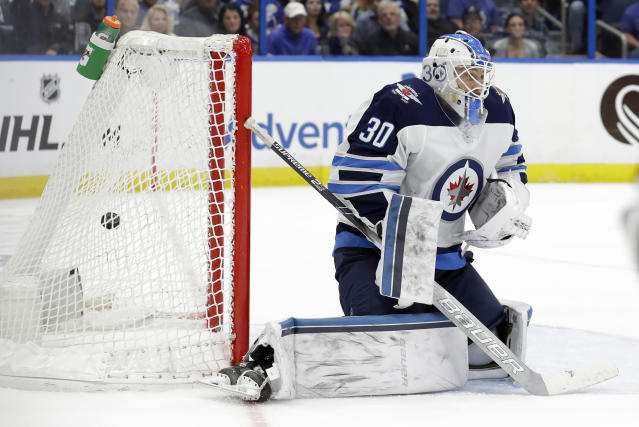 Winnipeg Jets goaltender Laurent Brossoit can't stop a shot by Tampa Bay Lightning center Steven Stamkos during the second period of an NHL hockey game Tuesday, March 5, 2019, in Tampa, Fla. (AP Photo/Chris O'Meara)