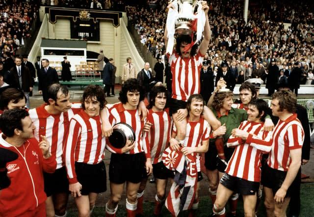 Sunderland's captain Bobby Kerr is held aloft by team-mates Billy Hughes and Jim Montgomery after the FA Cup Final victory over Leeds (PA)