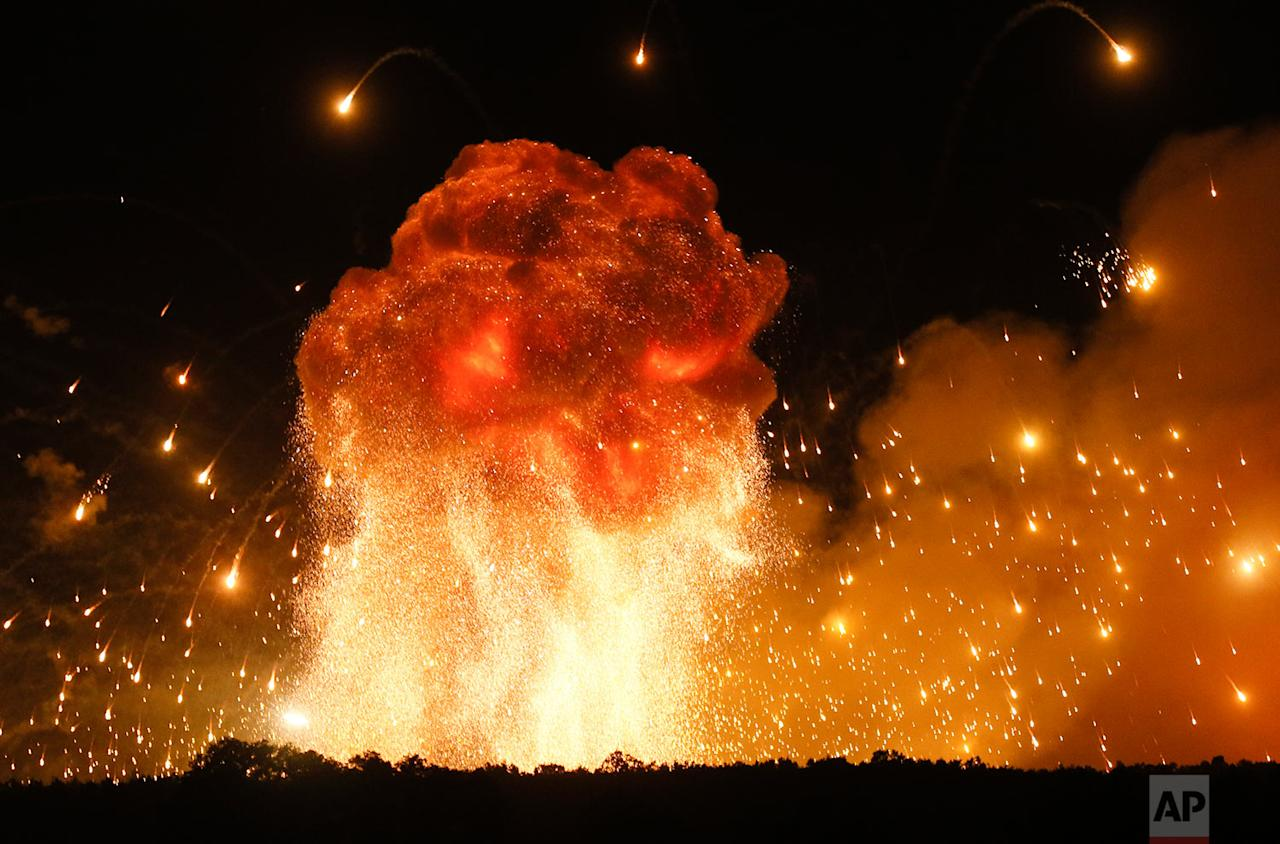<p>A powerful explosion is seen in the ammunition depot at a military base in Kalynivka, west of Kiev, Ukraine. Ukrainian officials say they have evacuated more than 30,000 people after a fire and ammunition explosions, at the military base. (AP Photo/Efrem Lukatsky) </p>