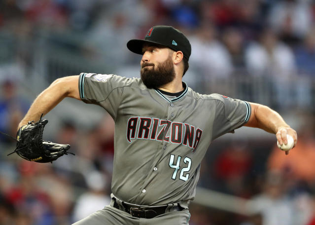 Arizona Diamondbacks starting pitcher Robbie Ray works in the third inning of a baseball game against the Atlanta Braves, Tuesday, April 16, 2019, in Atlanta. Players on both teams wore No. 42 in honor of Jackie Robinson. (AP Photo/John Bazemore)