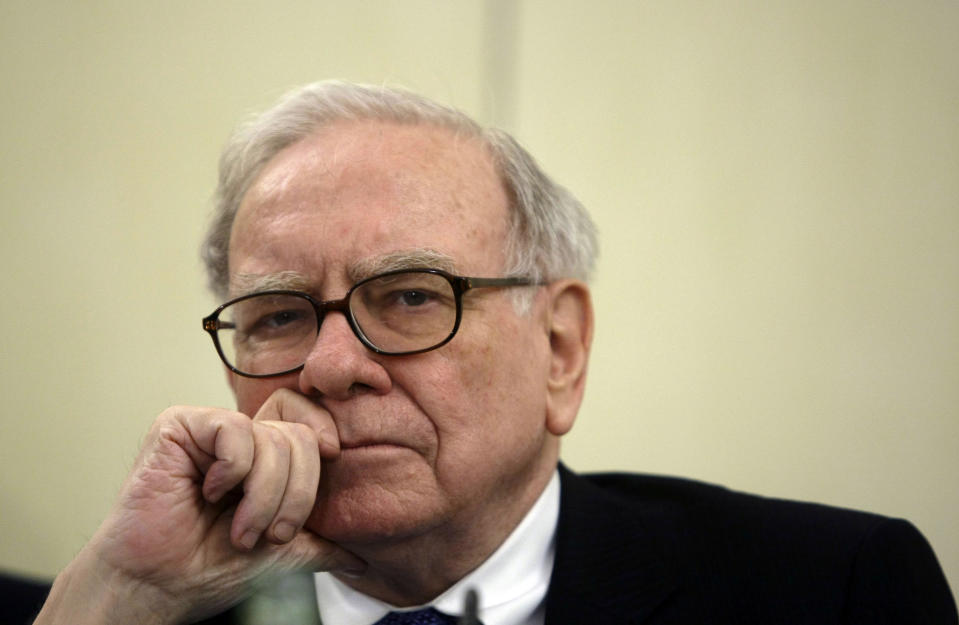 U.S. Investor Warren Buffett listens to a question during a news conference in Madrid May 21, 2008. Buffett, the world's richest man said on Wednesday that he saw the impact of the current financial crisis on the U.S. economy lasting longer than many people do. REUTERS/Andrea Comas (SPAIN) FOR BEST QUALITY IMAGE SEE: GM1E95V1AUI01