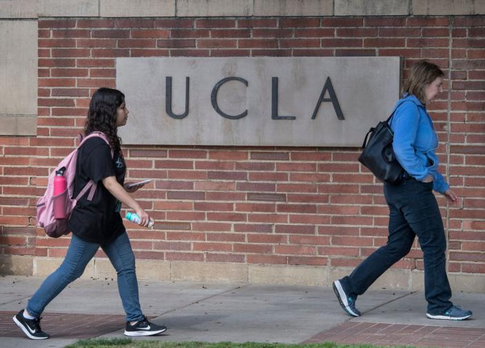 """<span class=""""caption"""">Public universities in California cannot consider race in admissions.</span> <span class=""""attribution""""><a class=""""link rapid-noclick-resp"""" href=""""https://www.gettyimages.com/detail/news-photo/people-walk-through-the-campus-of-the-ucla-college-in-news-photo/1205520367?adppopup=true"""" rel=""""nofollow noopener"""" target=""""_blank"""" data-ylk=""""slk:Mark Ralston / Getty"""">Mark Ralston / Getty</a></span>"""