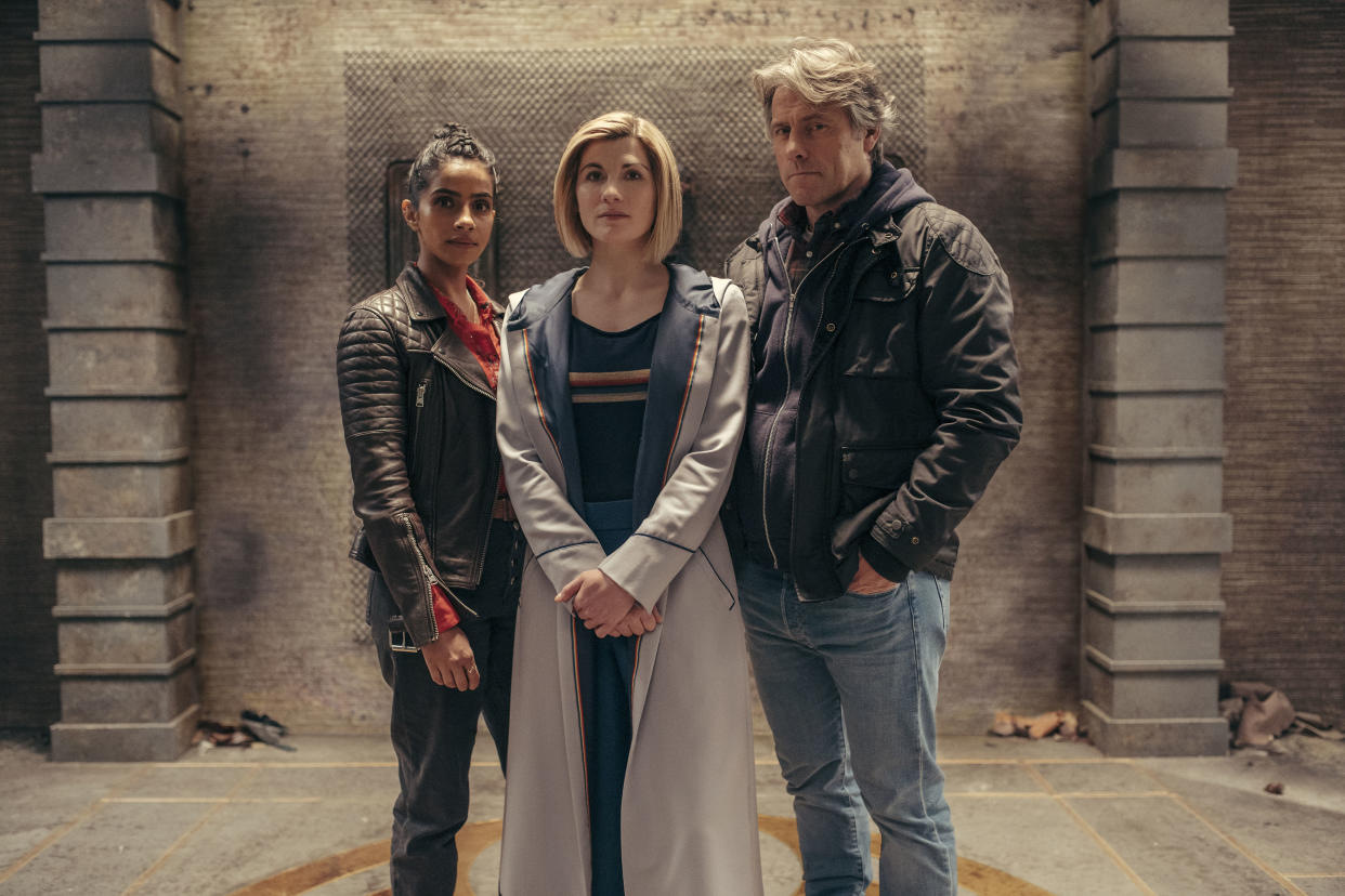 Jodie Whittaker (center, with Mandip Gill and John Bishop) will be stepping down as the Doctor. (Photo: BBC Studios/James Pardon)