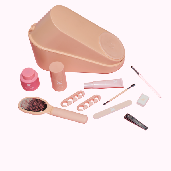 """<h2>Olive & June Pedi System Tool Box</h2><br>This all in-one-pedicure kit is a splurge, but if your best bud is strictly quarantining and hasn't been to a salon in months, Olive & June's DIY system is nothing short of a godsend. Along with the usual suspects (nail clippers, file, and buffer), the nail-care brand offers a foot file to smooth rough skin, a softening serum, and cuticle tools to tame unruly nail beds. The kicker is the one piece of equipment we probably all need the most: the Posey, a pantented plastic wedge for positioning your tootsies at a paintable angle.<br><br><em>Shop <strong><a href=""""https://oliveandjune.com/products/the-pedi-system"""" rel=""""nofollow noopener"""" target=""""_blank"""" data-ylk=""""slk:Olive & June"""" class=""""link rapid-noclick-resp"""">Olive & June</a></strong></em><br><br><strong>Olive & June</strong> The Pedi System (Tool Box), $, available at <a href=""""https://go.skimresources.com/?id=30283X879131&url=https%3A%2F%2Ffave.co%2F2HDScE2"""" rel=""""nofollow noopener"""" target=""""_blank"""" data-ylk=""""slk:Olive & June"""" class=""""link rapid-noclick-resp"""">Olive & June</a>"""