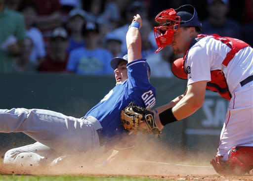Kansas City Royals' Johnny Giavotella, left, scores on an RBI-single by Royals' Tony Abreu off a pitch from Boston Red Sox's Felix Doubront as Red Sox's Ryan Lavarnway, right, tries to make the play in the fourth inning of a baseball game at Fenway Park in Boston, Sunday, Aug. 26, 2012. (AP Photo/Steven Senne)