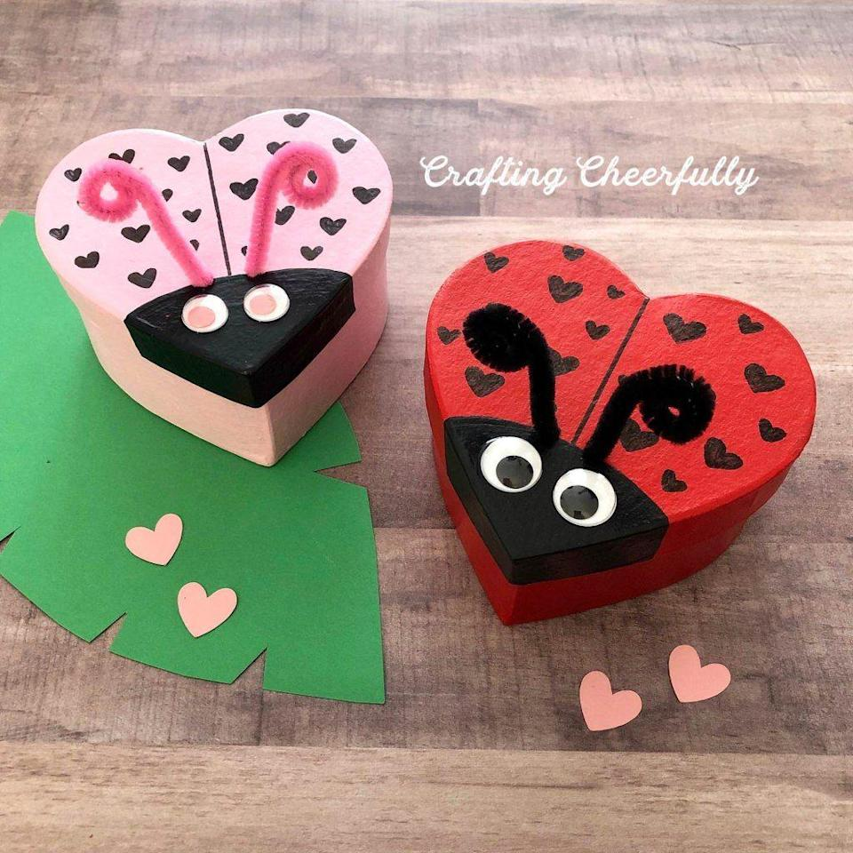 """<p>These sweet lovebugs are designed for gift-giving, but add a slot, and you've got the cutest Valentine's box ever!</p><p><strong>Get the tutorial at </strong><a href=""""https://www.craftingcheerfully.com/valentines-day-diy-love-bug-boxes/"""" rel=""""nofollow noopener"""" target=""""_blank"""" data-ylk=""""slk:Crafting Cheerfully."""" class=""""link rapid-noclick-resp""""><strong>Crafting Cheerfully.</strong></a></p><p><a class=""""link rapid-noclick-resp"""" href=""""https://www.amazon.com/Apple-Barrel-Acrylic-Paint-Valentines/dp/B019QTGGJO/?tag=syn-yahoo-20&ascsubtag=%5Bartid%7C2164.g.35119968%5Bsrc%7Cyahoo-us"""" rel=""""nofollow noopener"""" target=""""_blank"""" data-ylk=""""slk:SHOP CRAFT PAINTS"""">SHOP CRAFT PAINTS</a></p>"""