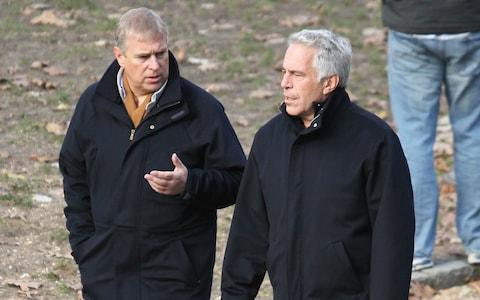 Prince Andrew smiling as he stands with his left arm around the waist of Virginia Roberts. It is alleged to have been taken in early 2001. Ghislaine Maxwell stands behind. - Credit: Jae Donnelly